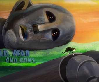 """Czarny kot przechadza się wewnątrz umierającego robota z okładki płyty Queen """"News of the World"""""""